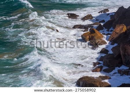Water, waves and cliff rocks in Atlantic ocean - stock photo