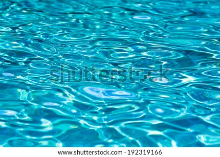Water waves in the pool. - stock photo