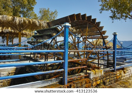 water wheel at the Beach in village of Karavomilos, Kefalonia, Ionian islands, Greece  - stock photo