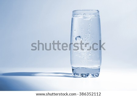 water with air bubbles in transparent glass