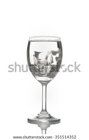 Water with ice cubes. Isolated on white background - stock photo