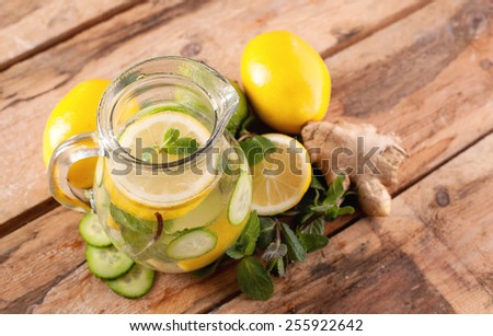 Water with lemon, mint, ginger and cucumber - stock photo