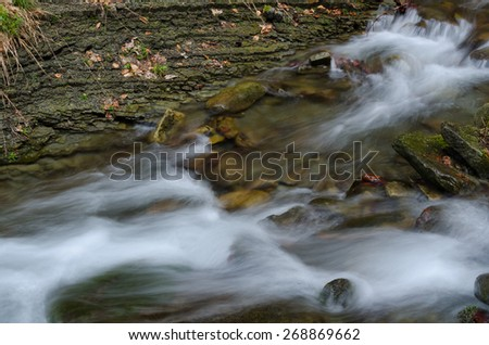 Water with rocks - stock photo