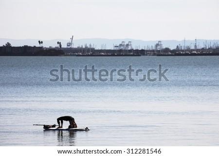 Water yoga. - stock photo
