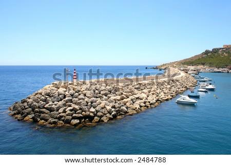 Waterbreak of Mgarr port on Gozo island, Malta - stock photo