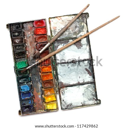 Watercolor paint box with messy brushes - stock photo