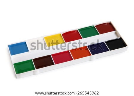 Watercolor paint in white box on white background - stock photo
