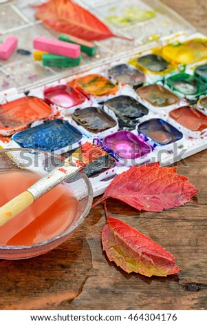 Watercolor paint,paint brush for painting and autumn leaves