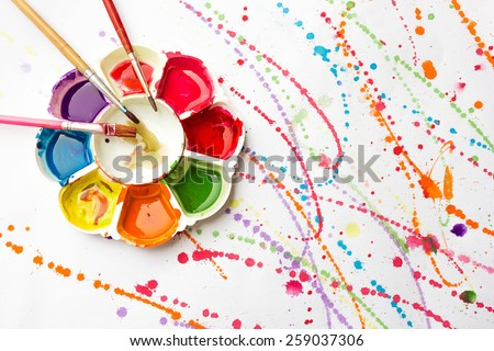 Watercolor paint tray with brush on painting background. Art and abstract background. - stock photo