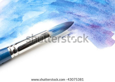 Watercolor Paintbrush on Painted Surface - stock photo