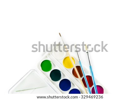 Watercolor paints set with a brush isolated on a white background - stock photo