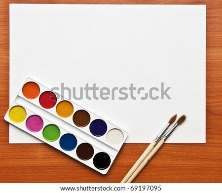Watercolor paints set with brushes and paper sheet - stock photo