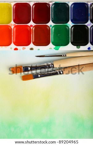 watercolor paints with brushes - stock photo