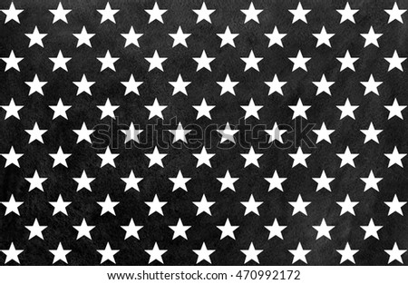 Watercolor pattern with white stars on black background.