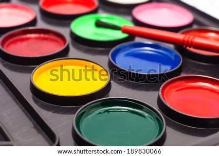 Watercolors and brushes for kids - stock photo