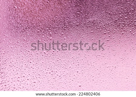 Waterdrop on a glass made with pastel tones - stock photo