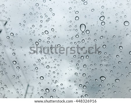Waterdrops on a glass surface windows with cityscape background. soft focus. art photo. filter effect. vintage style - stock photo