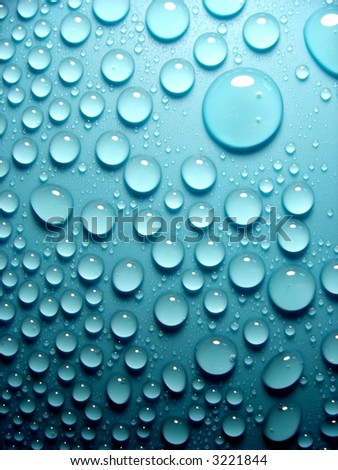 waterdrops on blue - stock photo