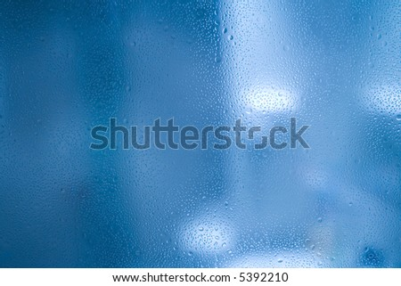 Waterdrops on glass - abstract background - stock photo