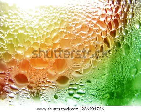 Waterdrops on red and green background  - stock photo