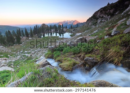 Waterfall and alpine lake in the Wasatch Mountains, Utah, USA. - stock photo