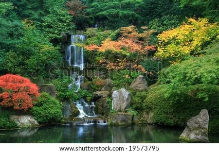 Waterfall and Autumn Foliage - stock photo