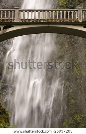 Waterfall and bridge in outdoor nature park - stock photo