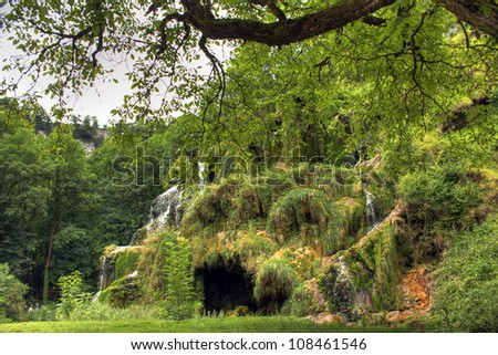 Waterfall and cave at Baume les Messieurs, Jura - France - stock photo