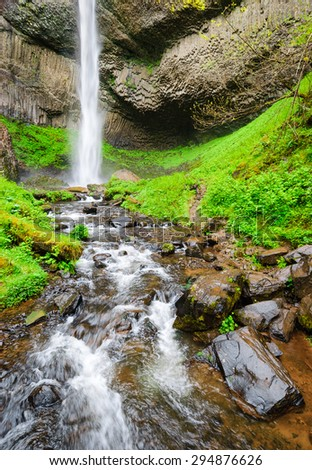 Waterfall and Flowing River at Columbia, Columbia Gorge - stock photo