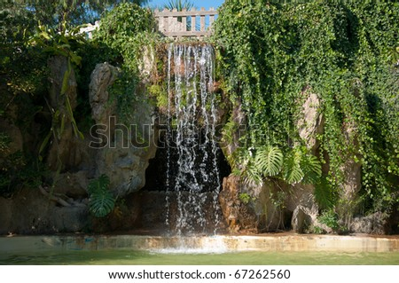 Waterfall and grotto in the Genoves park of Cadiz - stock photo