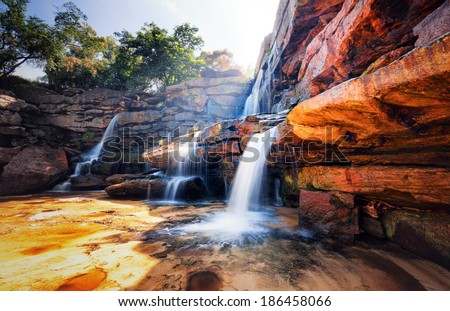 Waterfall and mountain landscape. Fresh water river stream flowing through beautiful rocky canyon. Nature photography  - stock photo