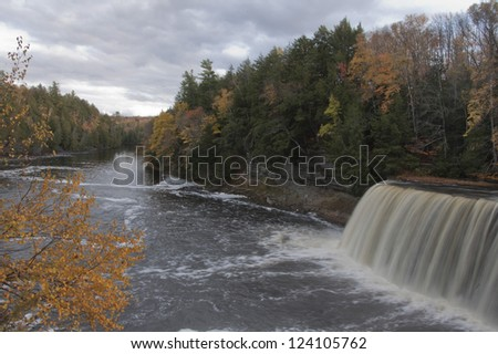 Waterfall and river in fall colors
