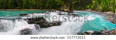 Waterfall and river views of the scenic Frasier River, Mount Robson Provincial Park, British Columbia Canada