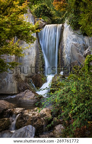 Waterfall and rocks in Japanese garden. Monte Carlo, Monaco. - stock photo