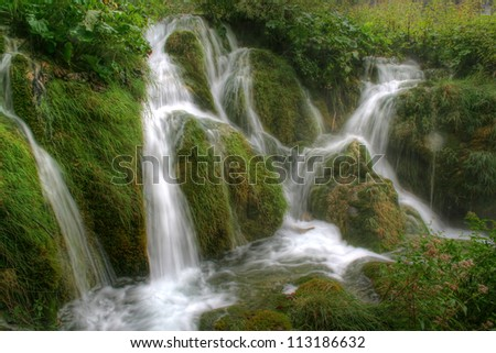 Waterfall as streams, in the Natural Park Plitvice Lakes, Croatia
