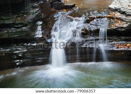 waterfall closeup in woods with rocks and stream in Watkins Glen state park in New York State - stock photo