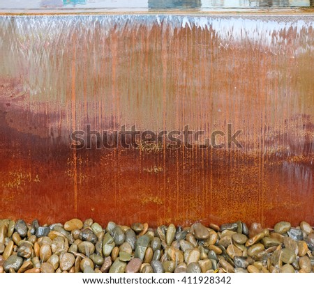 Waterfall from a fountain cascading over cement sink - stock photo