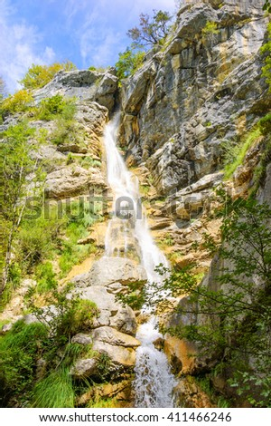 Waterfall from rocks in the forest forest. Annecy lake area (Haute-Savoie, France). - stock photo