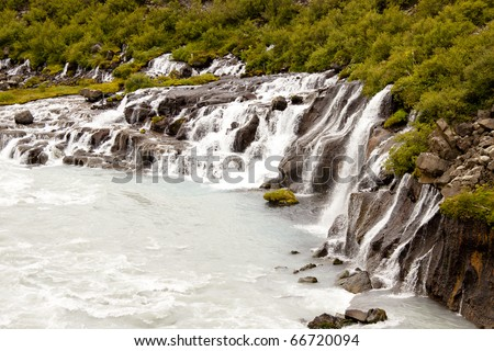 Waterfall Hraunfossar, big and beauty. Summer time in Iceland. - stock photo