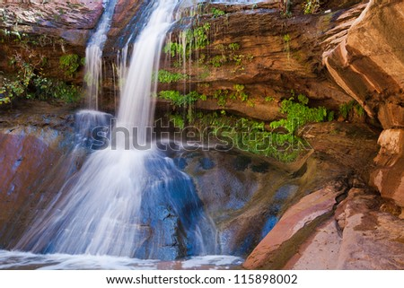 Waterfall in a Cove at Zions - stock photo