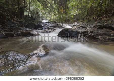 Waterfall in a lush rainforest  - stock photo