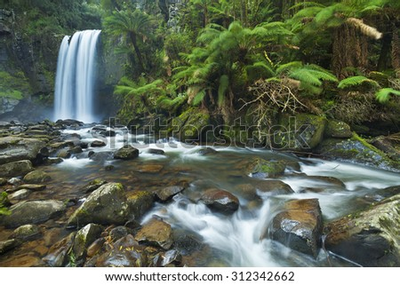 Waterfall in a lush rainforest. Photographed at the Hopetoun Falls in the Great Otway National Park in Victoria, Australia. - stock photo