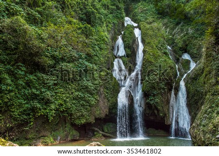 Waterfall in a lush rainforest. Vegas grande waterfall in Topes de Collante, Trinidad, Cuba - stock photo