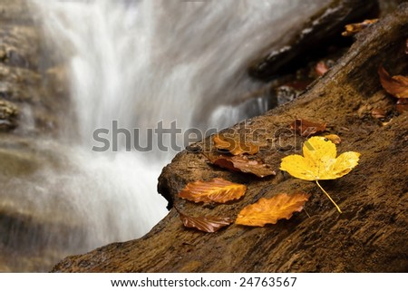 waterfall in autumn - stock photo