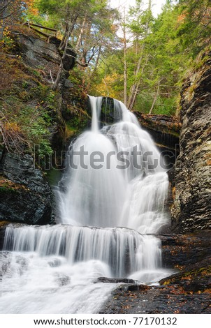 Waterfall in Autumn mountain with woods, foliage and rocks. From Digmans Fall of Pennsylvania - stock photo