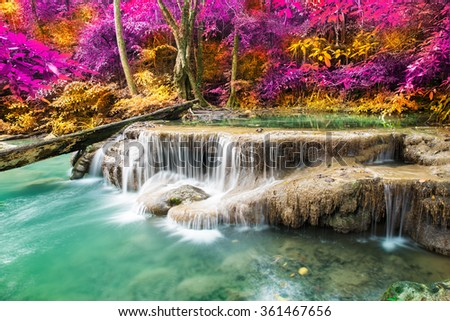 Waterfall in colorful autumn Deep forest at Erawan waterfall National Park, Thailand  - stock photo