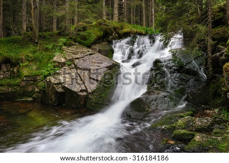 Waterfall in deep forest at mountains, Retezat national park, Romania - stock photo