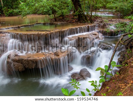 Waterfall in deep rain forest jungle. - stock photo