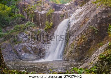 Waterfall in deep rain forest jungle. (Mae Re Wa Waterfalls Mokoju, Thailand). - stock photo