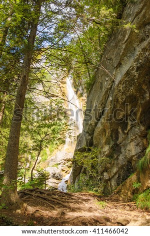 Waterfall in depths of a forest. Annecy lake area (Haute-Savoie, France).  - stock photo